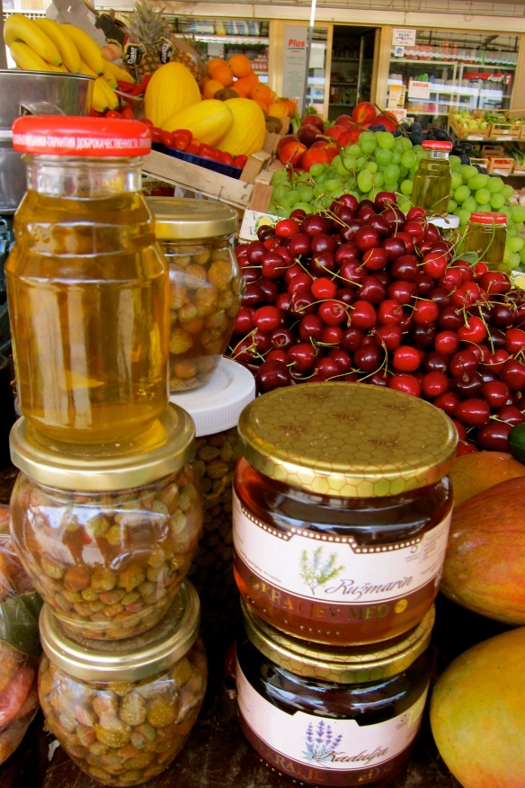 Honey, capers, and plump cherries at the Hvar town market